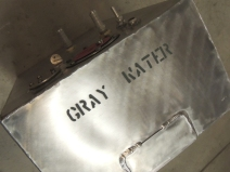 Labeled gray water tank with stencil