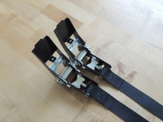 Sewed ratchet straps for under subframe box anti-rattle