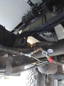 Added regulated air take-off from high pressure side of truck pneumatic system