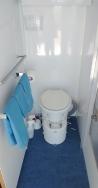 Installed bathroom door with mirror, waste basket, door handle, closing spring and towel bars