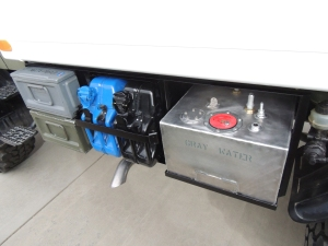 Installed driver side under subframe mount, storage boxes, Jerry cans, and gray water tank