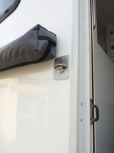 Installed external entry door grab handle