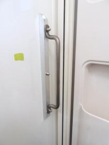 Installed forward internal grab handle