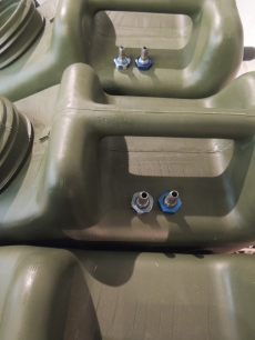 Installed machined barb bulkhead fittings in water Jerry cans