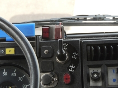 Modified and improved engine pre-heater switch mounting in truck cab