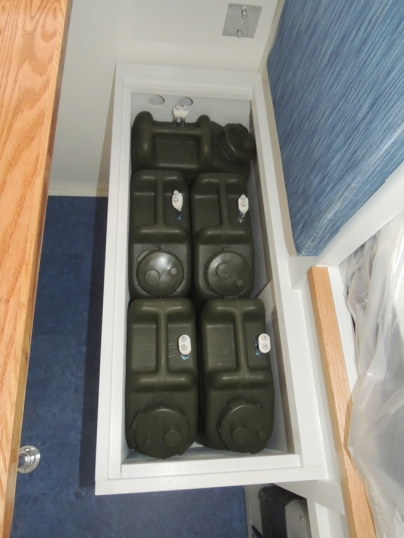 Stowed water Jerry cans in habitat